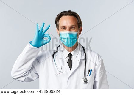 Covid-19, Preventing Virus, Healthcare Workers And Vaccination Concept. Satisfied Confident Doctor I