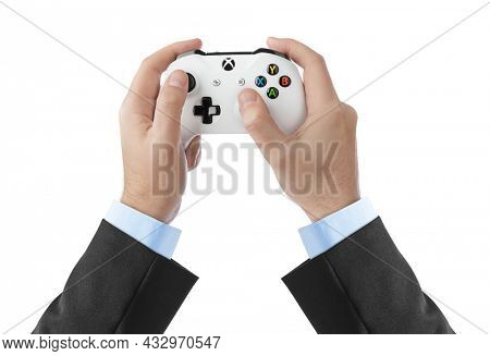 Moscow, Russia - April 18, 2019: Hands and wireless Xbox console gamepad - isolated on white background.