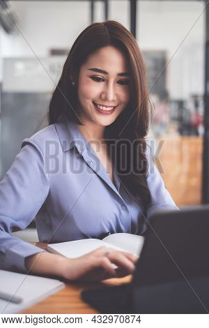 Photo Of Gorgeous Secretary Working At Office. She Sitting At The Wooden Desk