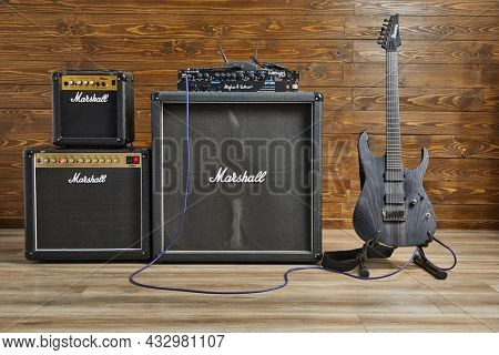 Budapest, Hungary - Circa 2021: Marshall guitar apmlifiers and electric guitar set up in a studio with an Ibanez guitar