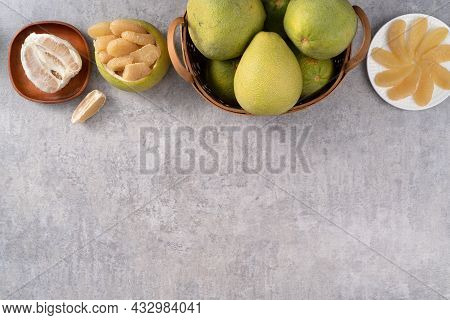 Fresh Pomelo Fruit On Gray Cement Table Background.