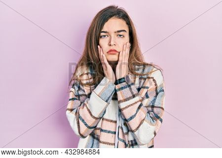 Young caucasian girl wearing casual clothes tired hands covering face, depression and sadness, upset and irritated for problem