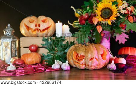 Halloween Orange Pumpkins With Scary Face. Autumn Fall Concept: Pumpkins, Candles, Sunflower, Leaves