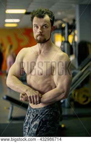 Handsome Young Man Of Athletic Physique Posing At The Camera.
