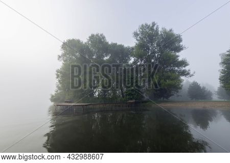 Picturesque Landscape Spring Evening. The River Overflowed In The Spring. Young Greenery On Trees An