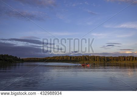 Sunrise Over The Foggy Lake With The Reflection Of Sun. Mist On The Water, Forest Silhouettes And Th
