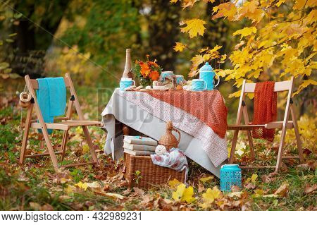 Table Prepared For Lunch In Autumn Nature, Picnic. Outdoors Picnic. Seasonal Concept