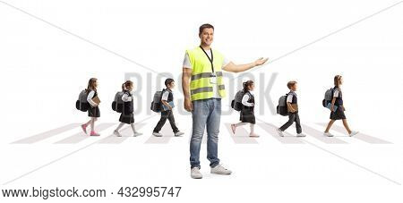 Community worker in a vest pointing at schoolchildren walking on a zebra crossing isolated on white background