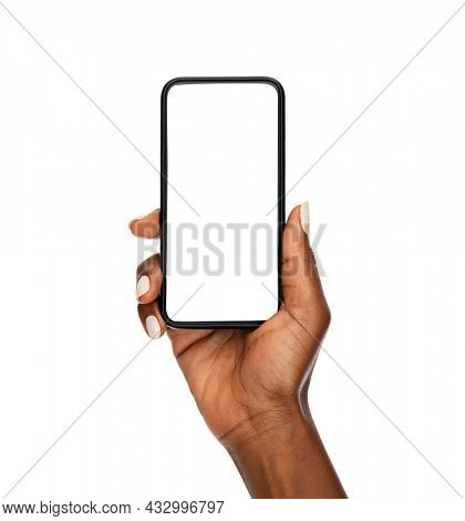 Close up of mature african hand holding smartphone with blank screen isolated on while background. Black woman showing empty screen of modern cellphone. Mature hand showing white screen of smart phone