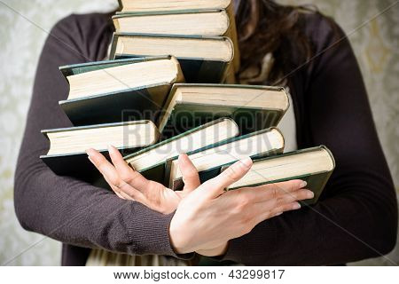 Student Holding Old Books