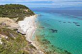 Sunny beach and summer resort at Kassandra of Halkidiki peninsula in Greece poster