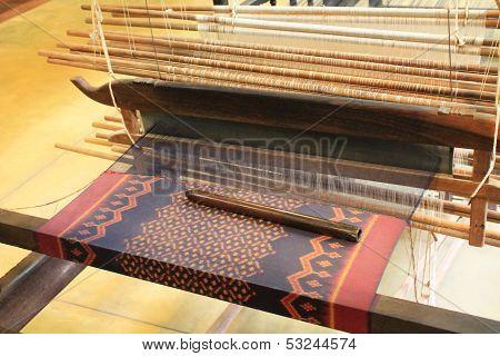 Weaving Silk Fabric On A Large Handloom Near Angkor Wat, Siem Reap, Cambodia