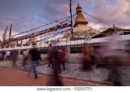 People walking around Boudhanath Stupa. Nepal