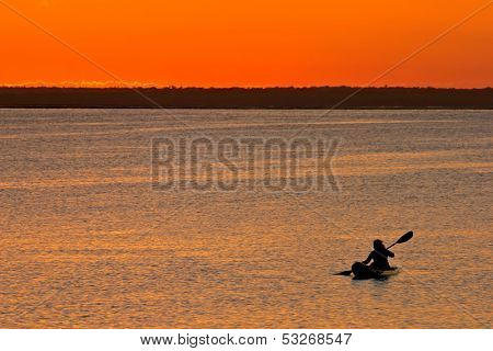 Golden sunset with canoeist, Vilanculos coastal sanctuary, Mozambique