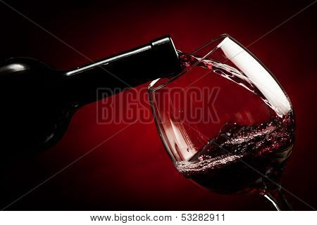 Bottle Filling The Glass Of Wine - Splash Of Delicious Flavor.