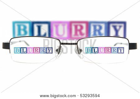 Letter Blocks Spelling Blurry Through A Pair Of Glasses