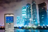 mobile phone with business background with office buildings poster