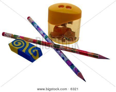 Colorful pencils, sharpner and eraser on white. poster