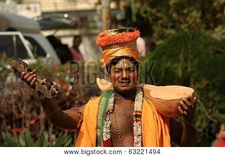 Haridasa singing Hindu prayers during pongalfestival