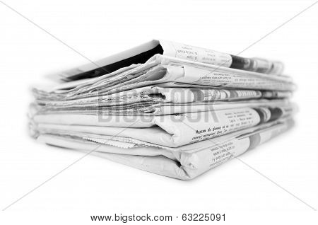 stack of old newspapers on an isolated white background poster