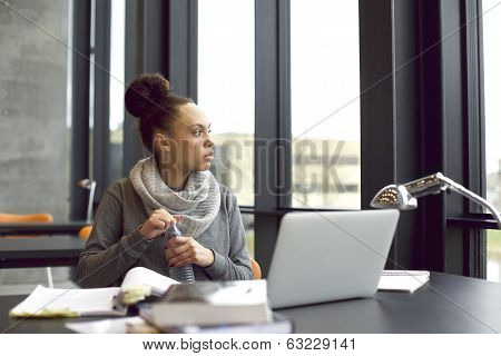 Woman Taking A Break While Studying In Library