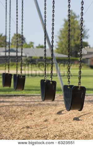 Empty Playground Swings
