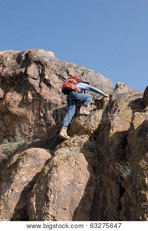 Mountaineer Climbs To The Top