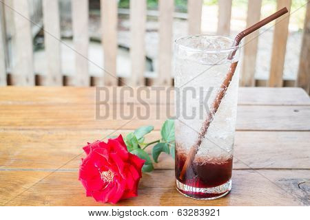 Iced Pomegranate Drink On Wood Table