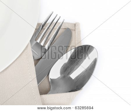 Knife fork and spoon with linen serviette isolated on the white background poster