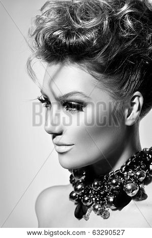 Glamour lady portrait. Beautiful model girl with perfect fashion makeup and hairstyle. Beauty young woman Vogue Style black and white portrait. Trendy accessories. Hairdressing