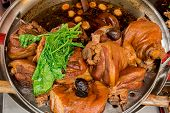 Close up pork leg pot stewed with egg on stainless steel pot poster