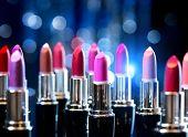 Lipstick. Makeup concept. Fashion Colorful Lipsticks. Professional Makeup and Beauty. Beautiful Make-up. Lipgloss. Lipsticks closeup over blinking bokeh background poster