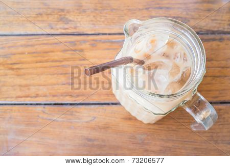 Fresh Iced Milk Coffee In Glass Pitcher