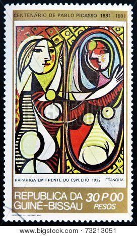 GUINEA - CIRCA 1981: A stamp printed in Republic of Guinea Bissau shows Girl Before A Mirror