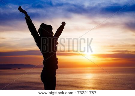 Female Freedom And Happiness On Sunset Towards The Ocean