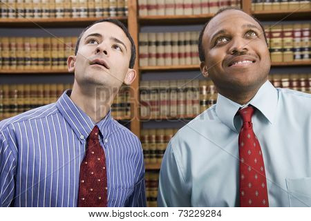 Multi-ethnic businessmen looking up