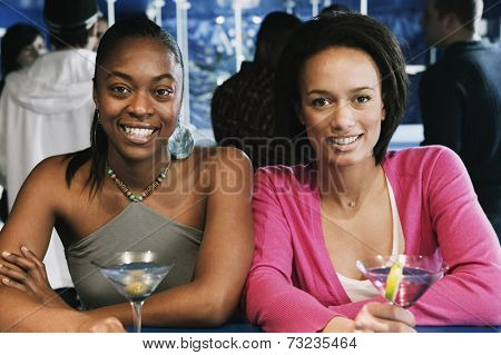 Portrait of two African women with cocktails