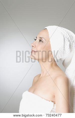 Hispanic woman wrapped in towels