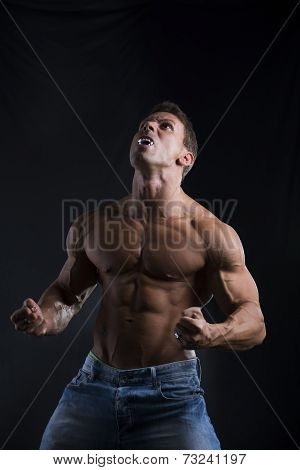 Shirtless Muscle Man With Pointed Teeth Howling