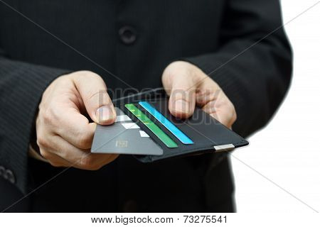 Businessman Pulling Credit Card From Wallet To Pay