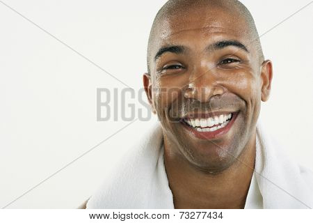 African American man with towel around neck