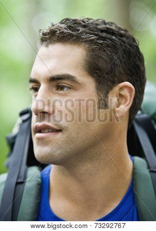 Hispanic man wearing backpack