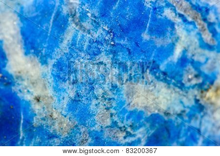 Macro Beautiful fantastic background from Lazurite is a tectosilicate mineral with sulphate, sulphur