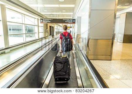 People With Baggage On A Moving Staircase