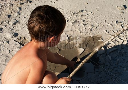 Thirsty little boy in the desert wondering where the water has gone in the exhausting heat poster