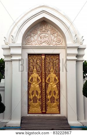 Thai Art Of Guardians On Temple Door Entrance.