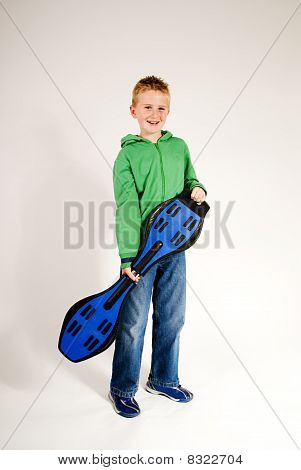 boy standing with waveboard