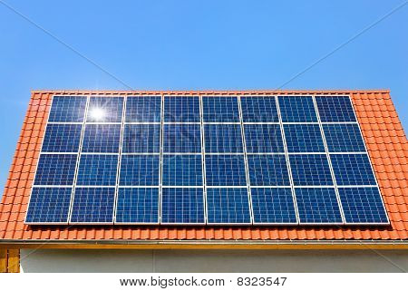 Solar Panel On A Roof Under The Cloudless Sky