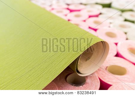a lot of new rolls of wallpaper closeup