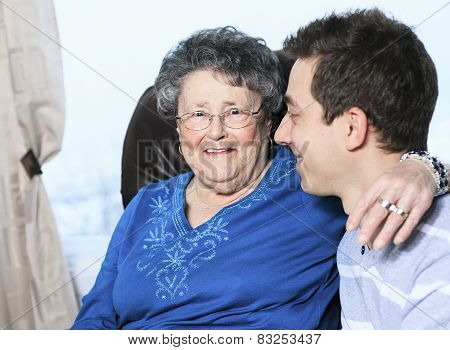 A grandchild with his grandmother in his room